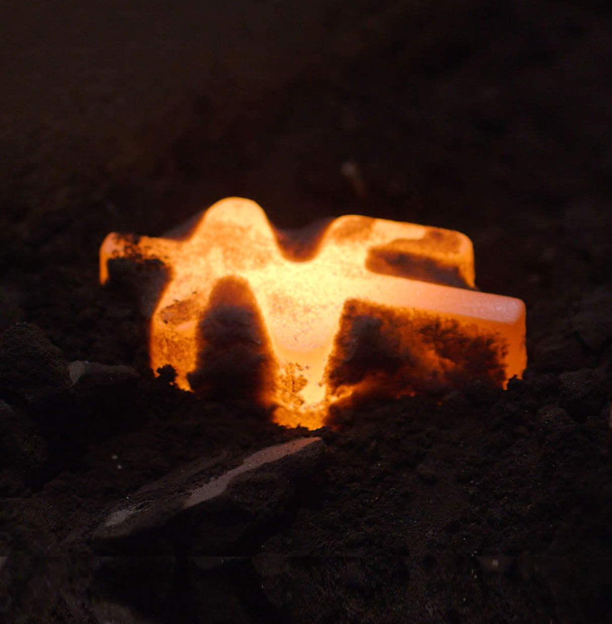 Glowing hot Nedre Foss logo, casted in solid iron